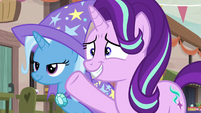 Starlight Glimmer nervously waves to the villagers S6E25