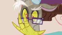 Discord looking at his transparent claw S7E12