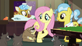 Lola the sloth hugging Fluttershy's leg S7E5.png