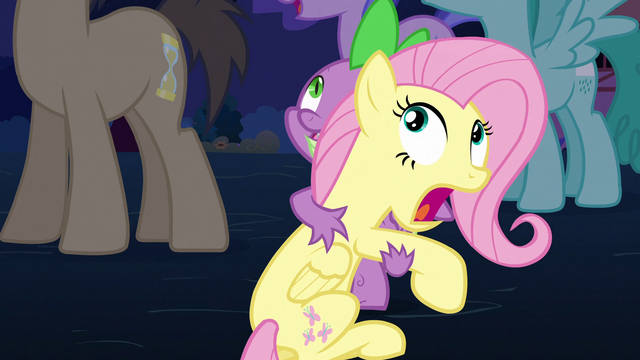 File:Spike holds Fluttershy S3E05.png