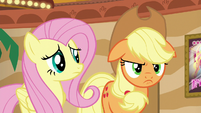 Fluttershy looking at Applejack's scowl S6E20