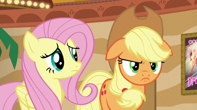 File:Fluttershy looking at Applejack's scowl S6E20.png