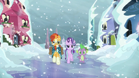 Sunburst, Starlight, and Spike walking towards the running crowd S6E2