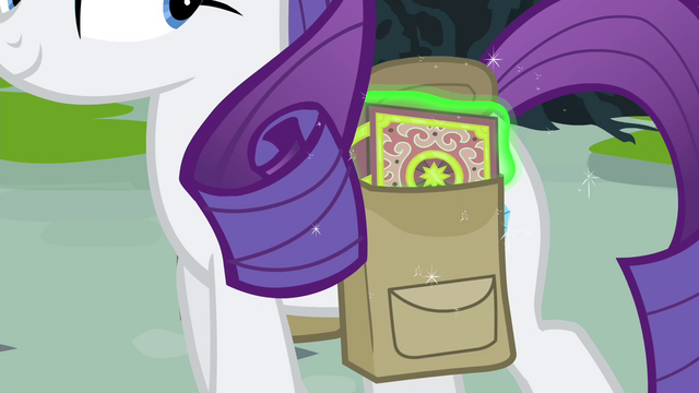 File:Rarity keeping the book in her saddlebag S4E23.png