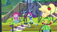 Pinkie and Rarity skate over the checkered line EG3