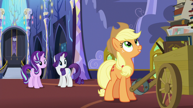 File:Applejack looking at her photo albums S6E21.png