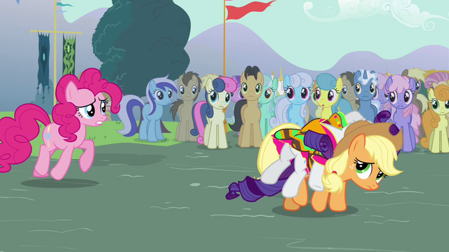 File:Applejack carrying a fainted Rarity S3E05.png