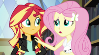 Fluttershy puts her hand on Sunset's shoulder EG3