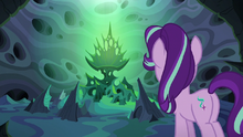 Thorax looking at Queen Chrysalis' throne S6E26.png