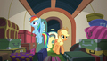Applejack and Rainbow enter the luggage car S6E18.png