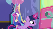 Twilight steps onto small stage with large gift box S7E1