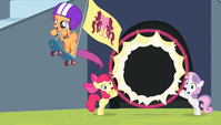 Scootaloo breaking through the hoop S4E24