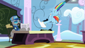Rainbow throws test on examiner's desk S4E21.png