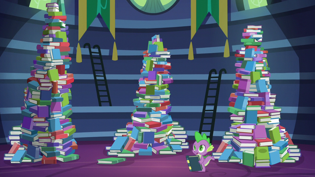 File:Spike standing besides the mountains of books S5E22.png