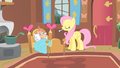 Fluttershy giving thermometer to Philomena S1E22.png