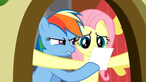 File:Rainbow Dash showing the photo S2E21.png