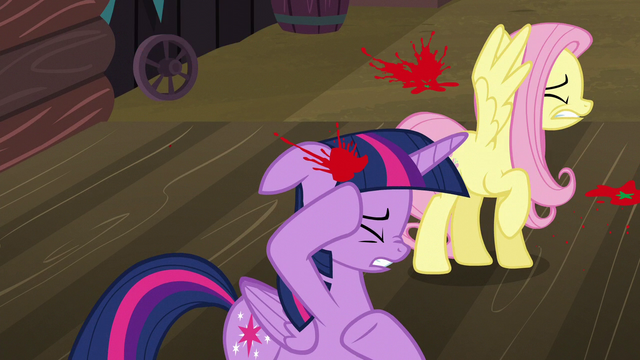 File:Twilight and Fluttershy shield themselves from tomatoes S5E23.png