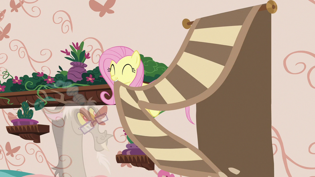 File:Fluttershy pulls decorative rug off the wall S7E12.png