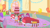 Pinkie Pie laying on the table with derpy eyes S1E25