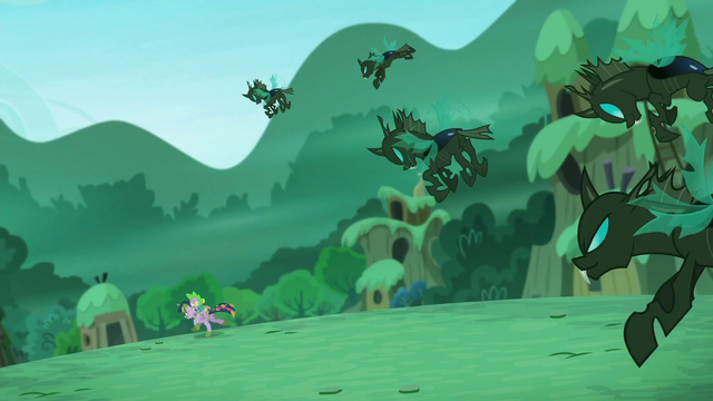 File:Changelings chase after Twilight and Spike S5E26.png