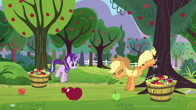 File:Applejack bucks apple tree; Starlight about to buck apple tree S5E26.png