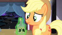 Bottle of tonic levitated onto Applejack's hoof S4E20
