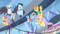 Fluttershy hands horseshoe to Rainbow Dash S4E24.png