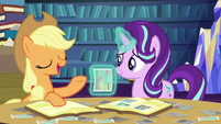 Applejack tells a story about the photo S6E21