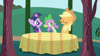 Applejack seats Twilight and Spike at a table S1E01