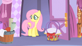 Fluttershy looks ar Rarity's material S1E17.png