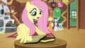 Fluttershy taking the books S3E10.png