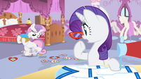 Rarity sees Sweetie tripping over the appliqués while carrying sequins S4E19
