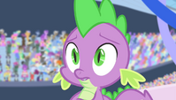 Spike surrounded by staring ponies S4E24