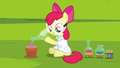 Apple Bloom putting liquid substance onto potting soil S4E15.png