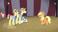 Applejack walking towards Flim and Flam S4E20