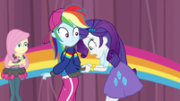 Rarity looks at tear in Rainbow Dash's jacket EGS1