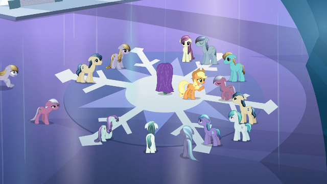 File:Applejack keeping depressed Crystal Ponies away from the fake crystal heart S3E02.png