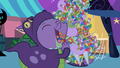 Spike shoveling candy into his mouth S2E4.png