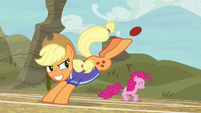 Applejack grins as she bucks the ball S6E18