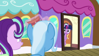 Twilight pokes her head out the train door S7E2