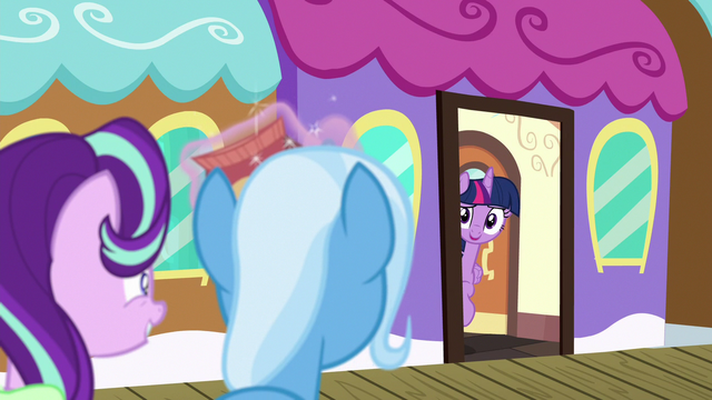 File:Twilight pokes her head out the train door S7E2.png
