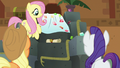 Jeweled cloth pulls back to reveal a scroll S7E2.png