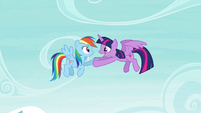 Twilight holds Rainbow's hoof S4E21