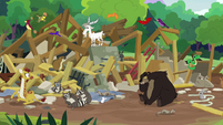 Animals in a pile of wood and stone rubble S7E5