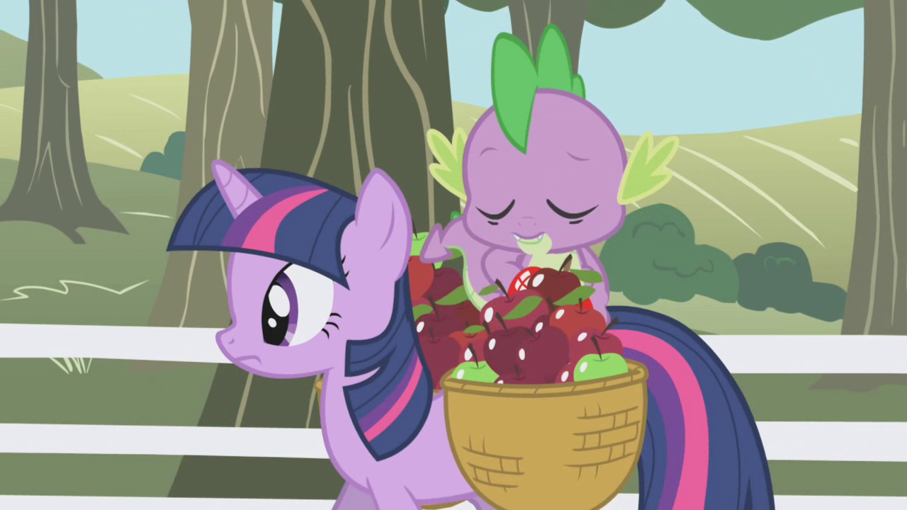 Spike pulling out a shiny red apple S01E03