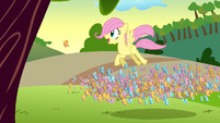 Filly Fluttershy flying above the butterflies S1E23