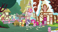 AJ, Rarity, Pinkie, and Spike behind Sugarcube Corner S7E9