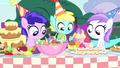 Foals looking at table of treats S4E23.png