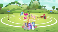 Applejack on buckball field explaining buckball to the unicorns S6E18