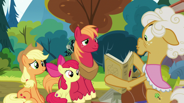 File:Goldie shows history book to Apple siblings S7E13.png